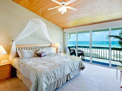 Photo for Beachfront condo w/ two decks, Gulf views & shared pool - walk to the trolley!