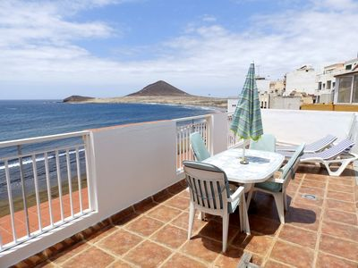 Photo for Beachfront Penthouse with terrace in El Medano (wifi + sat tv)