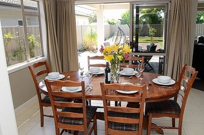 Dining table and access to sheltered outdoor dining patio