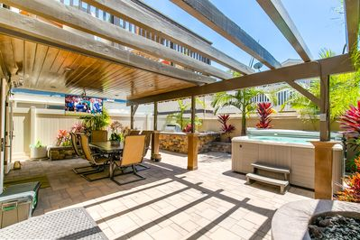 Entertainer's patio with built in BBQ, hot tub, fireplace/water feature and TV.