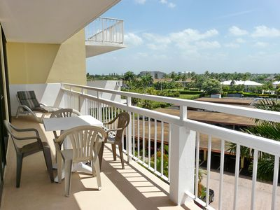 Photo for Inviting beachfront condo w/ spacious balcony & heated pool