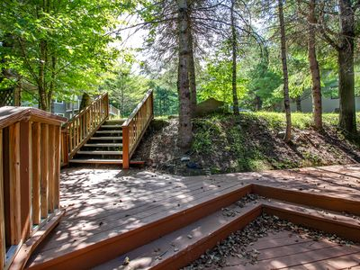 Photo for Cozy townhome w/ private hot tub, surrounded by trees, close to skiing and golf!