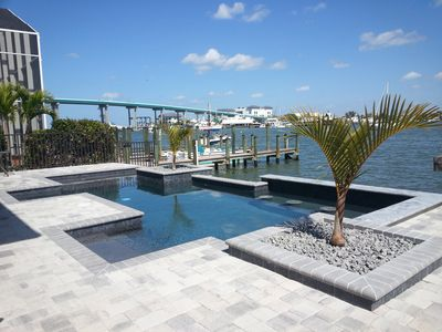 Photo for Amazing Bay Views, Pool, Private Boat Dock, Walking Distance to Times Square