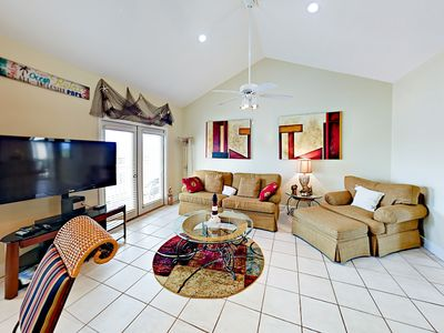 """Living Area - 50"""" flat screen TV in a spacious open living area. Entire rental is professionally cleaned between each stay."""