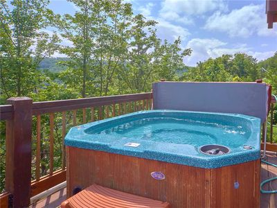 The bliss of an outdoor hot tub - There's no better way to revel in the beauty of the mountains, the singing of the birds, and the caress of the fresh breeze than while luxuriating in the steamy bubbles of the deck's hot tub.