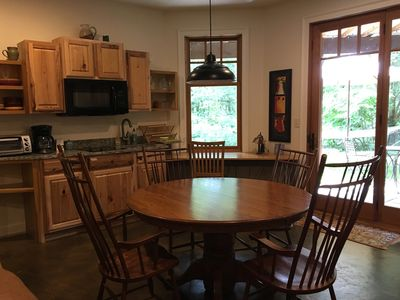The kitchen and dining area is filled with natural light.