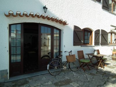 Photo for Spacious, traditional apartment with green courtyard by the sea