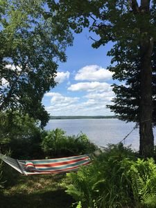Photo for Lake Front House ~ Fire pit ~ Canoes/Kayaks ~ Large Deck ~ Secluded Beach
