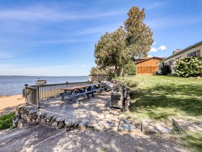 Photo for Quaint lakefront home w/ a large yard, sandy shores, only minutes to town!