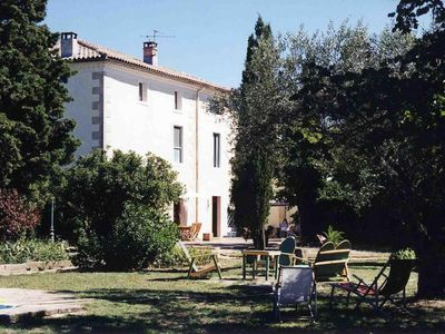 Photo for Near to Uzès, Provencal farmhouse with pool, surrounded by vineyards and olive trees