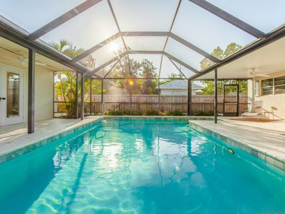 Photo for CARIBE COTTAGE - Family Friendly Central Naples Pool Home