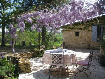Breakfast on the terrace under the wisteria.
