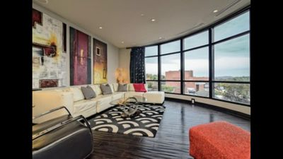 Living Room - Floor to Ceiling Windows, Black out Curtains & Panoramic Views.