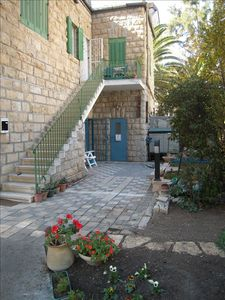 Entry to the lovely garden... the flat has the blue gate on the ground floor.