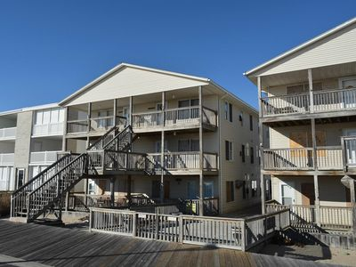 Photo for Sleek, yet cozy 2-bedroom oceanfront condo with free WiFi located directly on the Boardwalk and just steps to the beach!