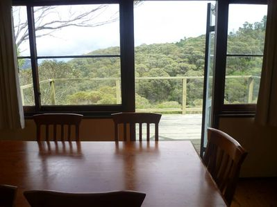 Dining room opens out to the deck, with valley views