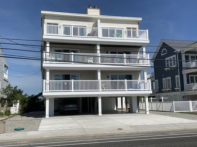 Photo for VIEWS! VIEWS! VIEWS! Enjoy fantastic Ocean and Bay Views from 4 decks.  Directly across the street to fantastic North End Beaches. Car port parking, Outdoor Shower, and Central air this unit has it all!