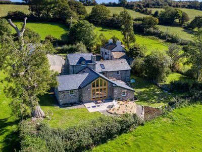 Photo for A recently converted barn that sits high above the beautiful Conwy Valley.