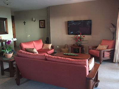 "Open concept living room with tasteful seating, BluRay and 50"" LED television"