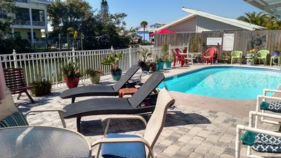 Photo for Waterfront (canal) cottage style 4-unit with heated pool, Lanai