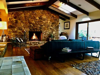 The living room, with a cozy fireplace and plenty of room to chill...