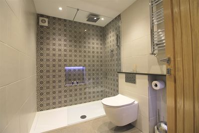 Luxurious shower room with rain shower and Elemis toiletries