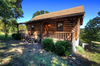 This Cypress Log Home sits on top of a hill over looking Table Rock Lake.