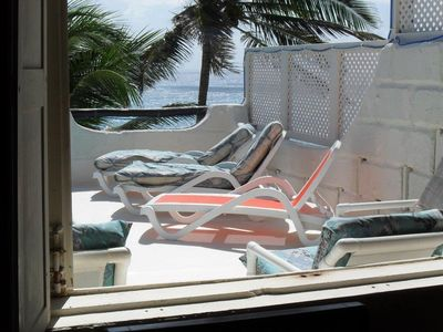 CHAISE LOUNGES ON POOL DECK