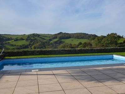 Heated outdoor swimming pool with stunning countryside views