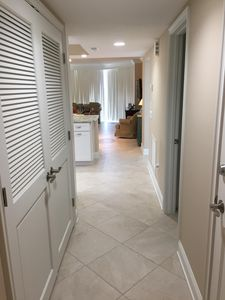The entrance foyer has a tray ceiling, recessed lighting.  The condo is tiled throughout.