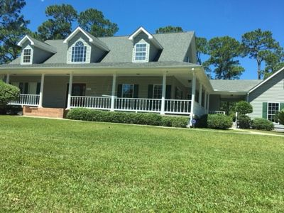 Photo for Beautiful Southern Style home On A Golf Course with Wrap Around Porches