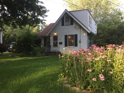 Front of house with flowers in the garden.
