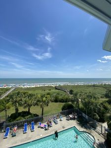 Photo for OCEANFRONT LARGE CONDO W/BALCONY! WATCH THE DOLPHINS FROM THE DECKS OVERLOOKING THE COMMUNITY POOL!!