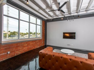 Photo for Indrustrial style loft with downtown views!