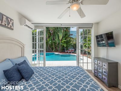 Photo for Entire 3/3 Duplex by the Beach & Airport - Luxury Backyard w Heated Pool & BBQ