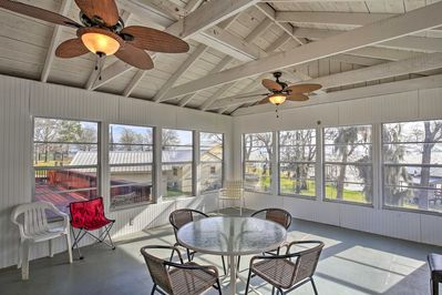 The group can gather in this sunroom to hang out while enjoying lake views.
