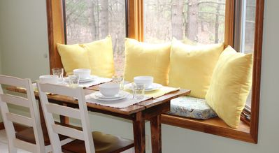 Seating for 4 thanks to this quaint window seat in the dining nook
