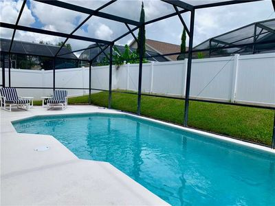 Photo for 4 bed private pool(private fence) Free Wifi 4 Miles to Disney!
