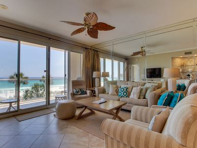 Photo for Luxurious beachfront condo w/ furnished patio plus a shared pool, gym, pool spa