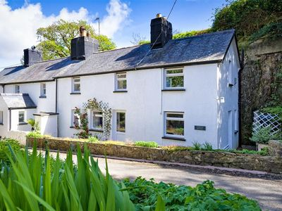 Photo for Situated in the coastal village of Llanbedrog, Tan Rallt is a beautiful Welsh cottage, incorporating