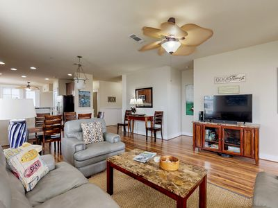 Photo for Luxurious oceanfront condo w/ shared hot tub & pool, nearby beach access!
