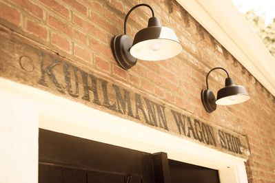 Original Kuhlmann Wagon Shop sign from the 1830 wheelwright