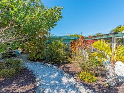 Photo for Charming, private cottage on beautiful north end of Anna Maria with heated pool