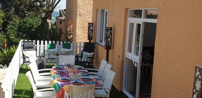 Photo for House with garden at 40 meters from the sand beach of la Fosca.