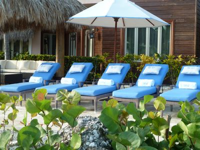 The villa is equipped with 12 lounge chairs that overlook the ocean.