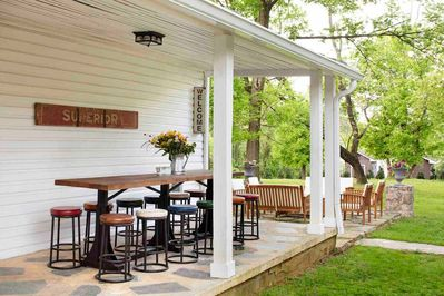 Large outdoor table on the side porch seats 12. Outdoor speakers for your tunes!