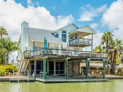 Photo for NEW LISTING! Waterfront home w/ deck, Tiki hut, hot tub & game room - dogs OK!