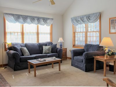 Photo for Charming two-bedroom condo in South Down Shores with beach access and sun room.