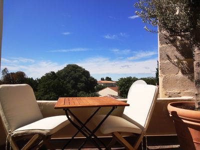 Photo for Very quiet terrace with a view, 80m² design in Uzes hist.center, 2 bedrooms, AC, WIFI