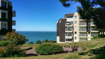 Photo for TROUVILLE: 2-room apartment, terrace. Magnificent sea view. Close to center & beach.